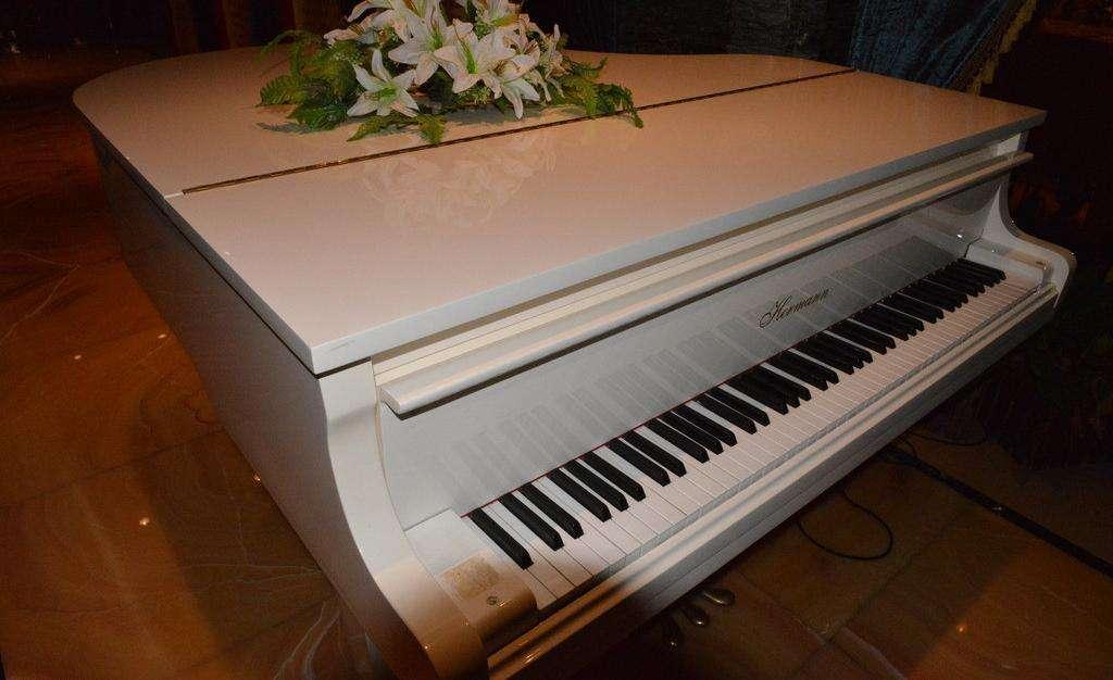 老地方的雨 钢琴曲谱